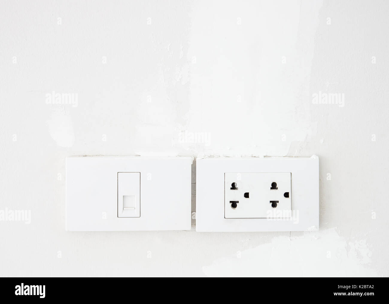 hight resolution of electrical switch and telephone socket on the white wall in the living room copy space