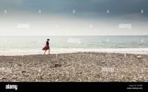 Girl Beach Footprints In Sand Stock &
