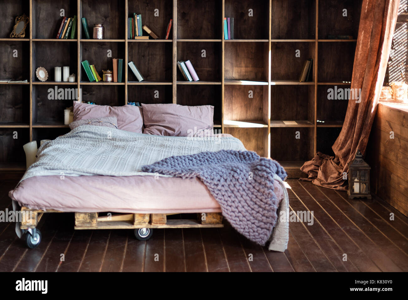 Modern Bedroom In A Loft Urban Apartment With Pallet Bed
