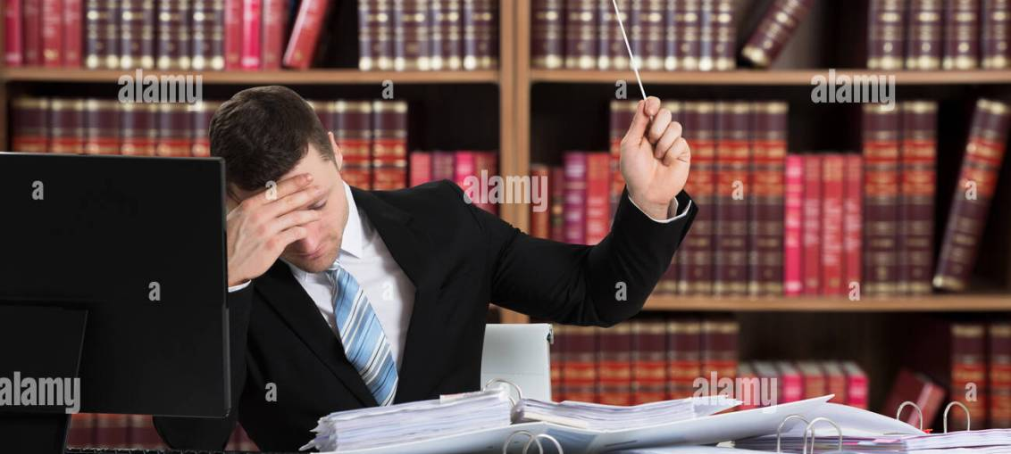 Young Frustrated Male Lawyer With A Load Of Work Holding Help Flag In Stock Photo 162513129 Alamy