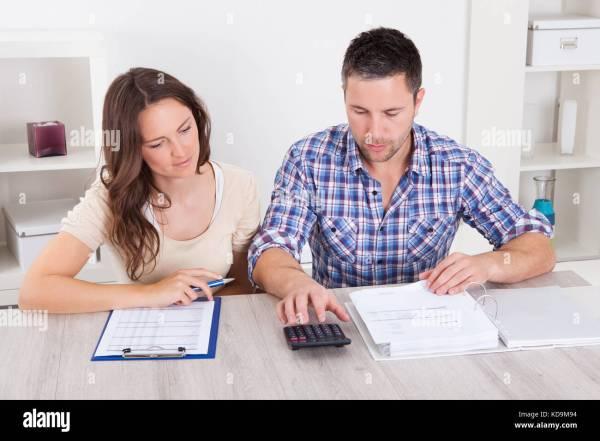 Couple Pay Bills Stock Photos & Couple Pay Bills Stock ...