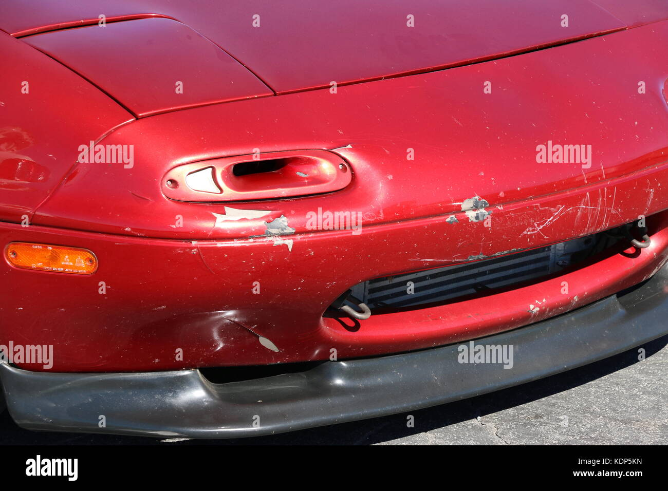 hight resolution of unusual turn signal on an old red car with fender in need of repair