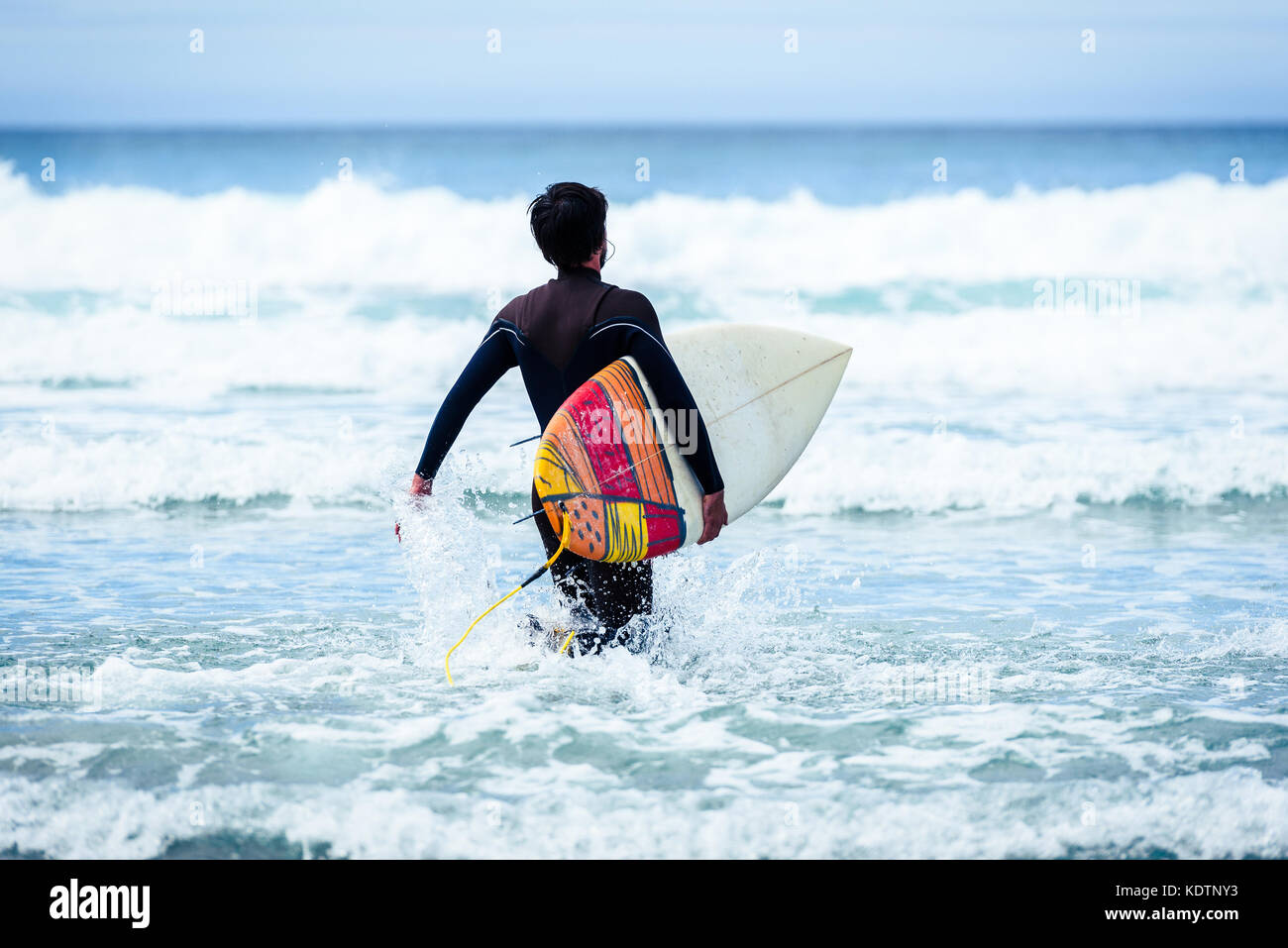surfer guy with surfboard