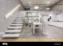 Loft Apartment With White Mezzanine Staircase Table
