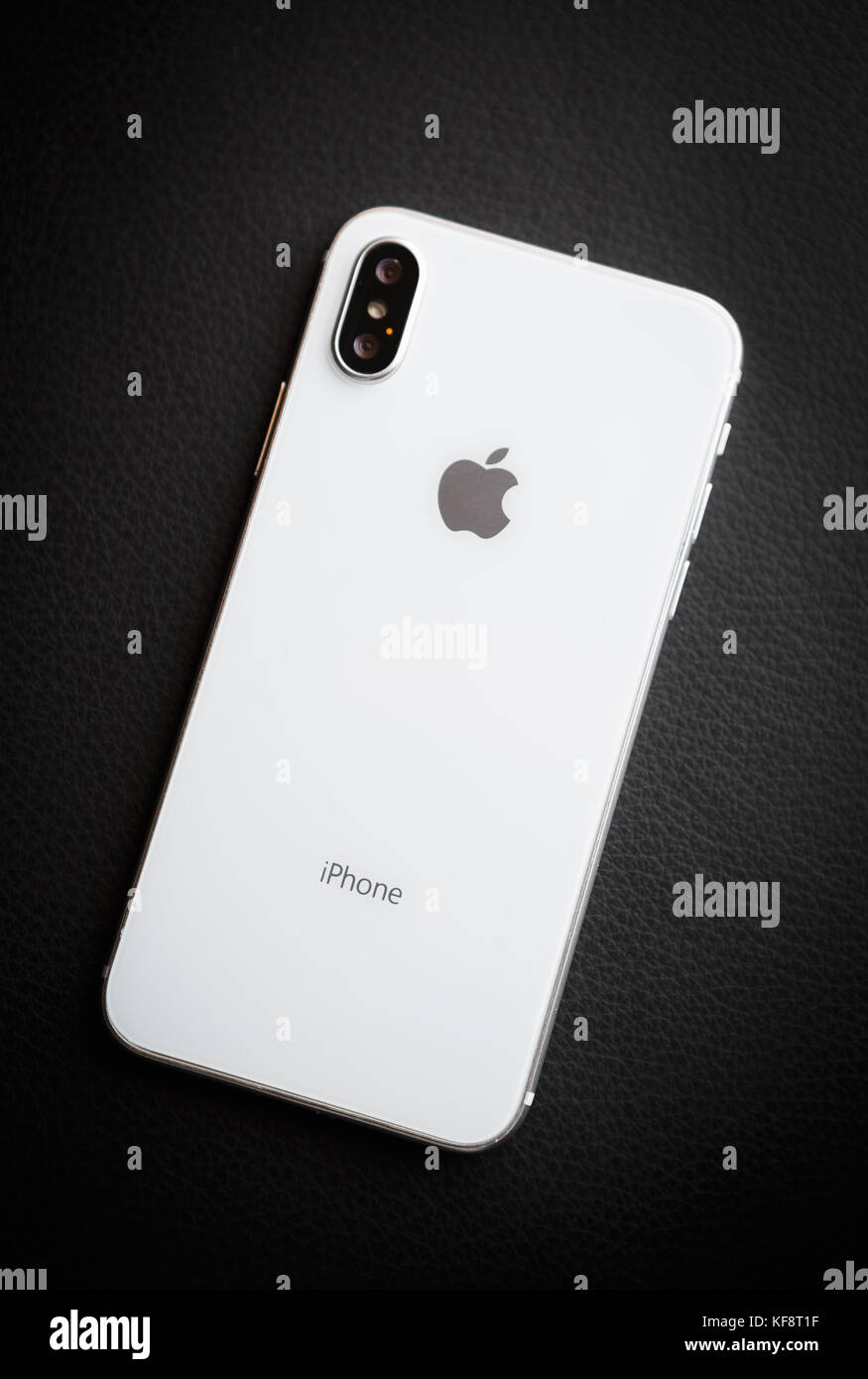 hight resolution of new iphone x model close up modern iphone 10 smart phone model trendy mobile device white apple iphone mobile phone with big screen and dual camera