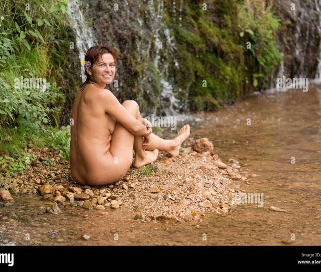 Woman Of 40 Years Sitting Without Clothes In The River World In Lietor In The Province Of Albacete Spain