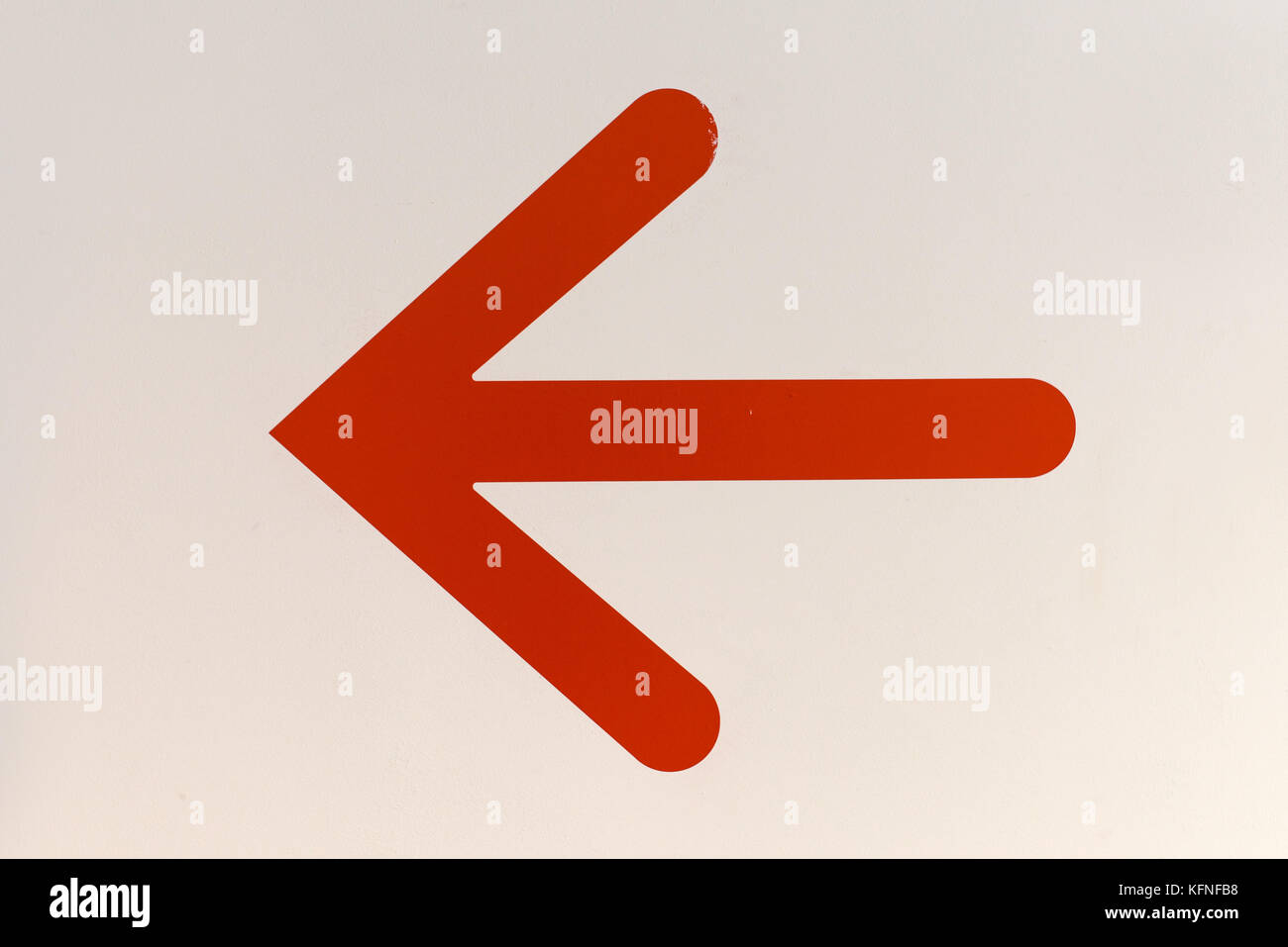 red arrow symbol pointing
