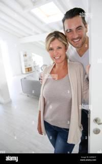 Woman Opening Front Door Man Stock Photos & Woman Opening