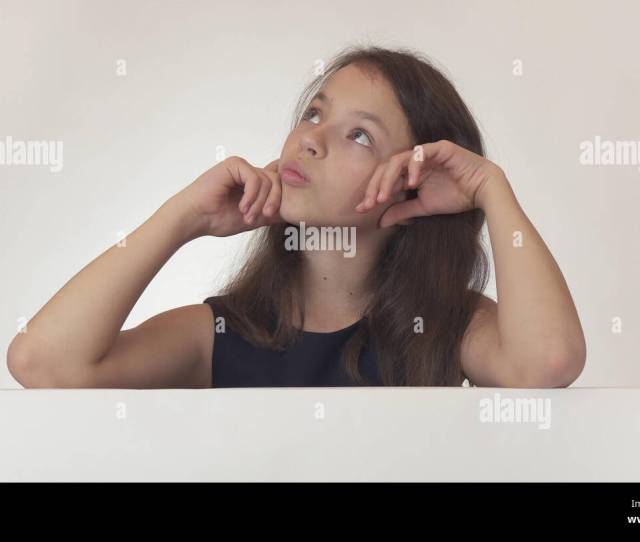 Beautiful Girl Teenager Pondered Over The Poster With Information On White Background