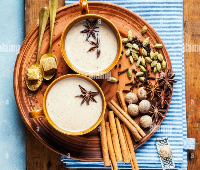 Masala Tea Chai Latte Traditional Hot Indian Teatime Ceremony Sweet Milk With Spices Herbs Organic Infusion Healthy Beverage In Porcelain Cup On Wood