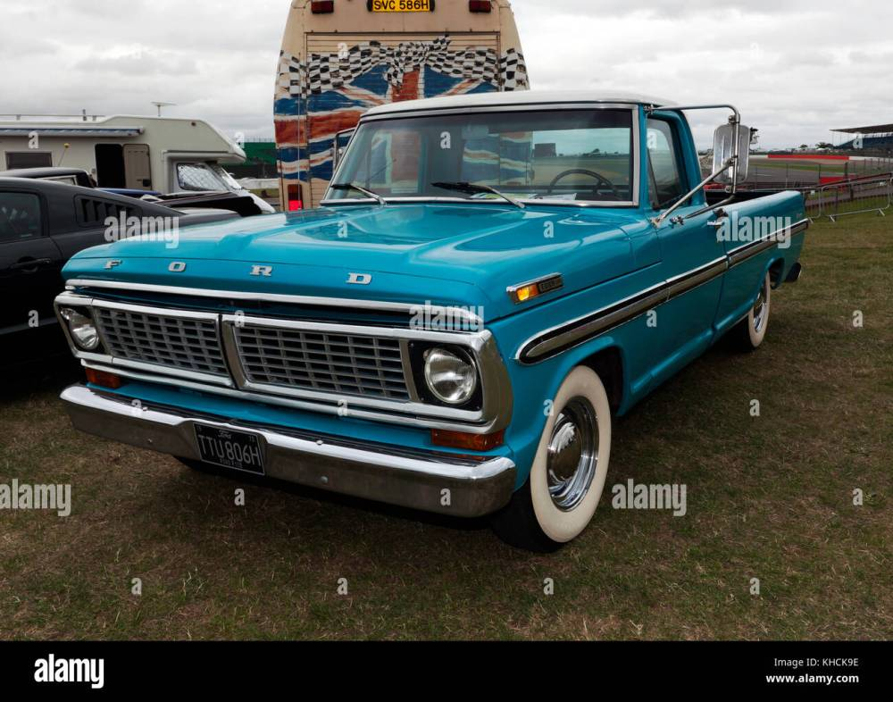 medium resolution of three quarter front view of a 1970 ford f100 pick up truck