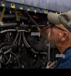 an airplane mechanic contracted through kay and associates inc clips a wiring harness on a c 130h engine nov 13 2017 at mclaughlin air national guard  [ 1300 x 909 Pixel ]