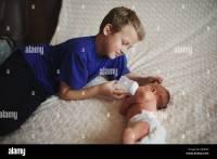 Feeding Baby Bottle Sister Stock Photos & Feeding Baby ...