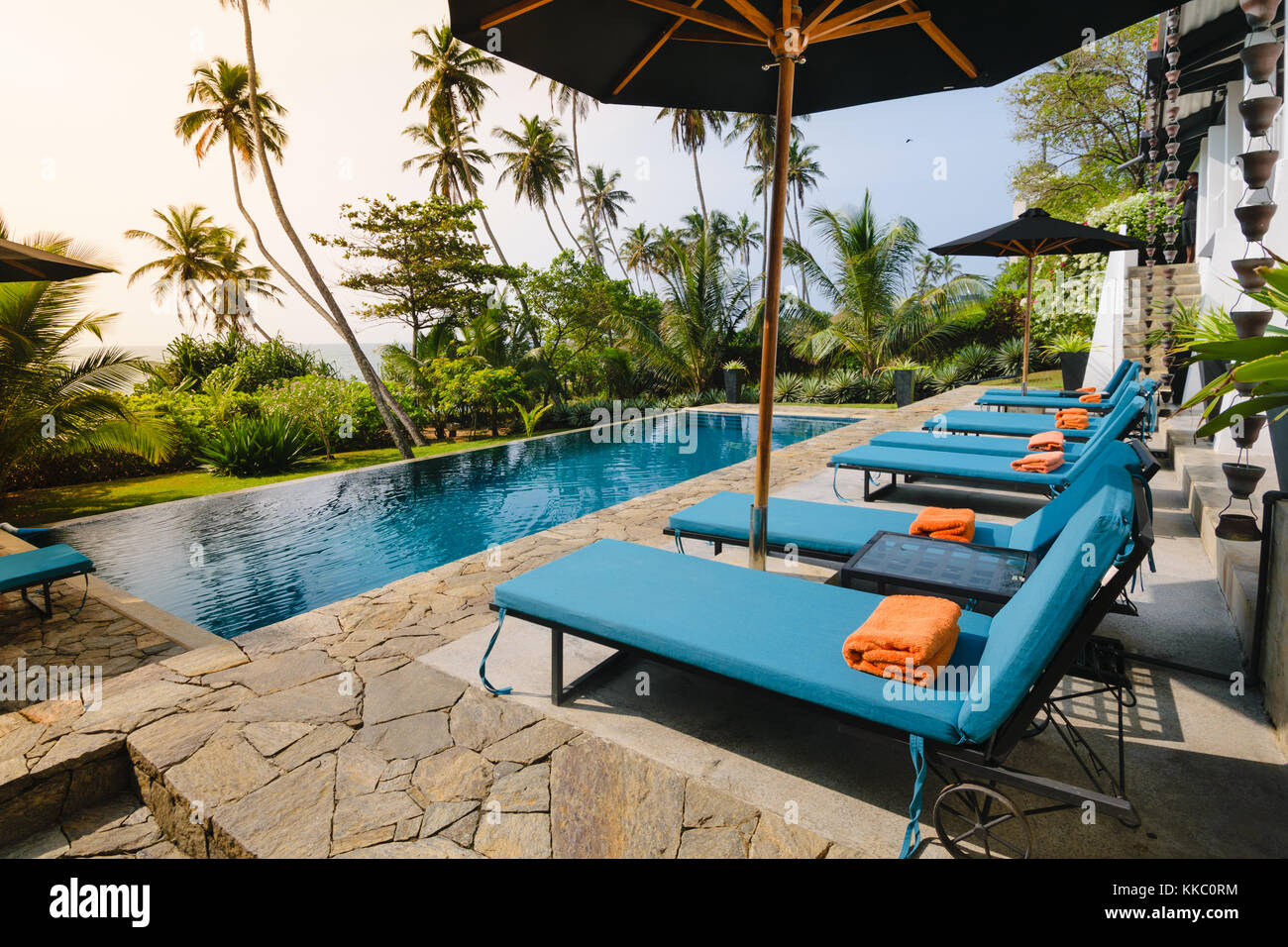 Chairs For Pool Swimming Pool And Lounge Chairs Facing A Garden And The Sea In