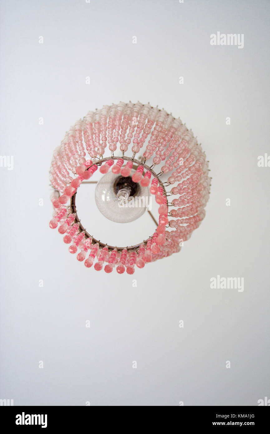 Pink Chandelier Lampshade Hanging From The Ceiling In A Child S Stock Photo Alamy