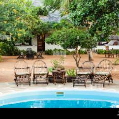 What Are Pool Chairs Made Out Of Foldable Lounge Elegant Wood Close To A Swimming Inside Kenyan Garden