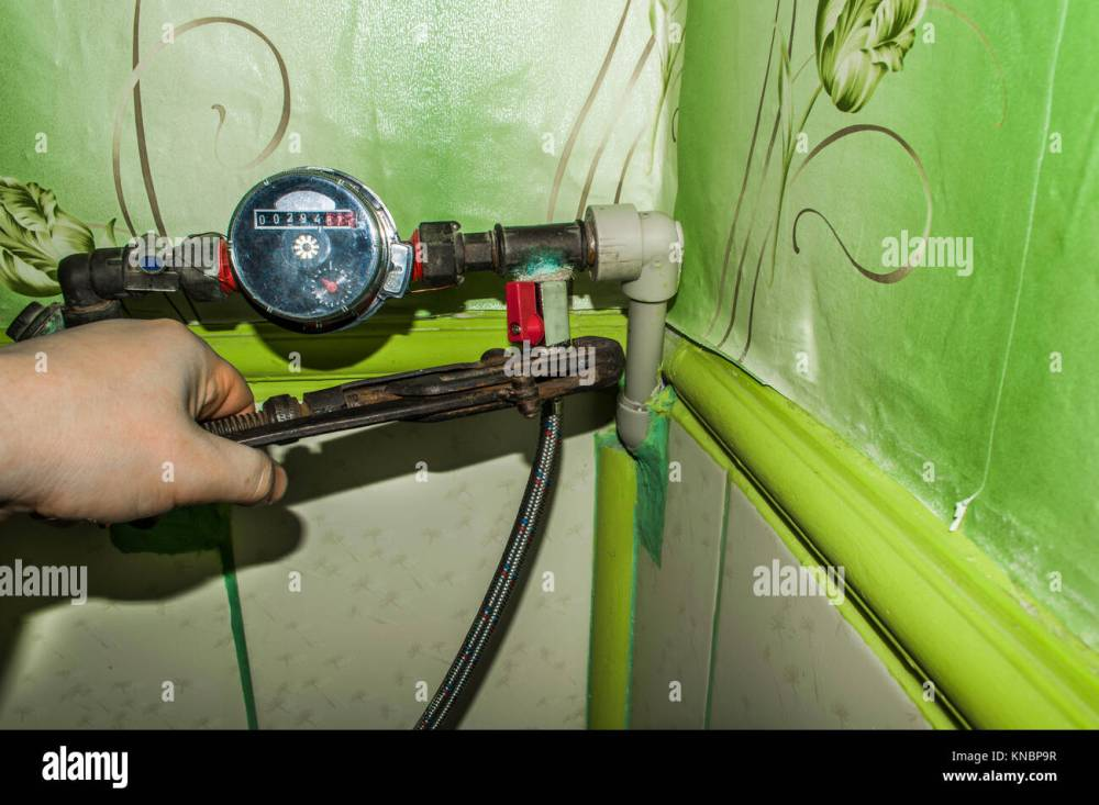 medium resolution of mounting water meter for plumber work with the key old pipes and key
