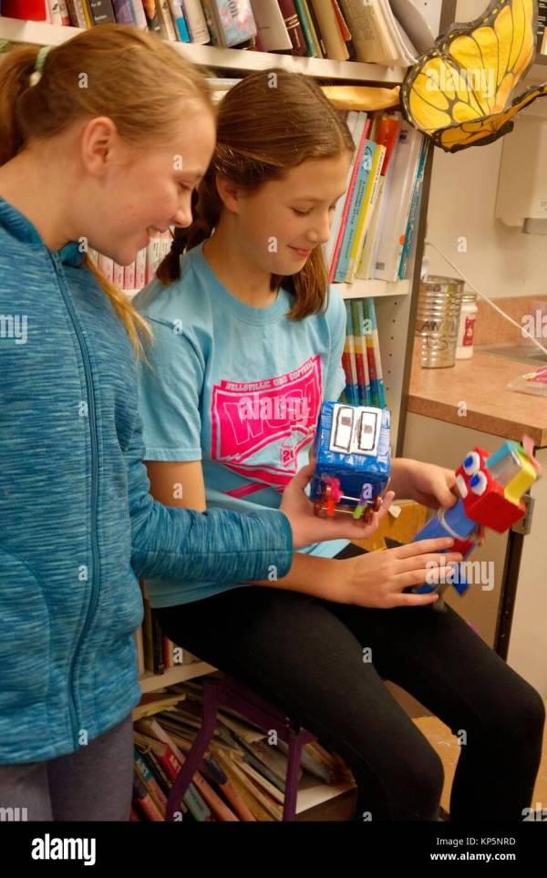 Girl Building Robot Stock &