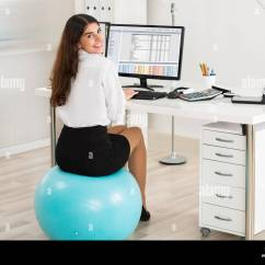 Exercise Ball Chair For Back Pain White Covers With Gold Bows Best House Interior Today Posture Work Desk Woman Stock Photos