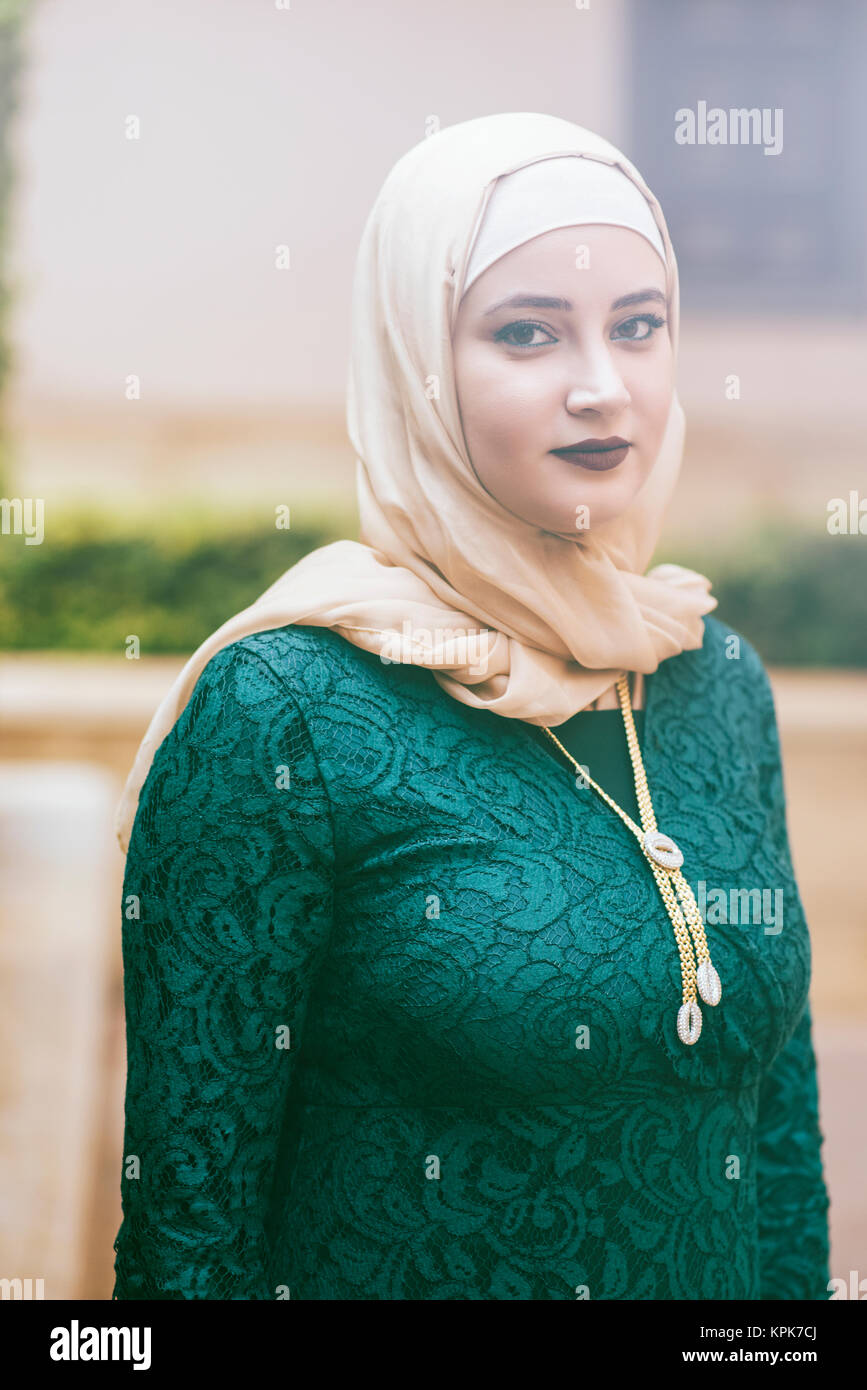 It is, first and foremost, an act of worship among muslim women. Beautiful Muslim Woman Wearing Hijab Standing Outdoors Stock Photo Alamy