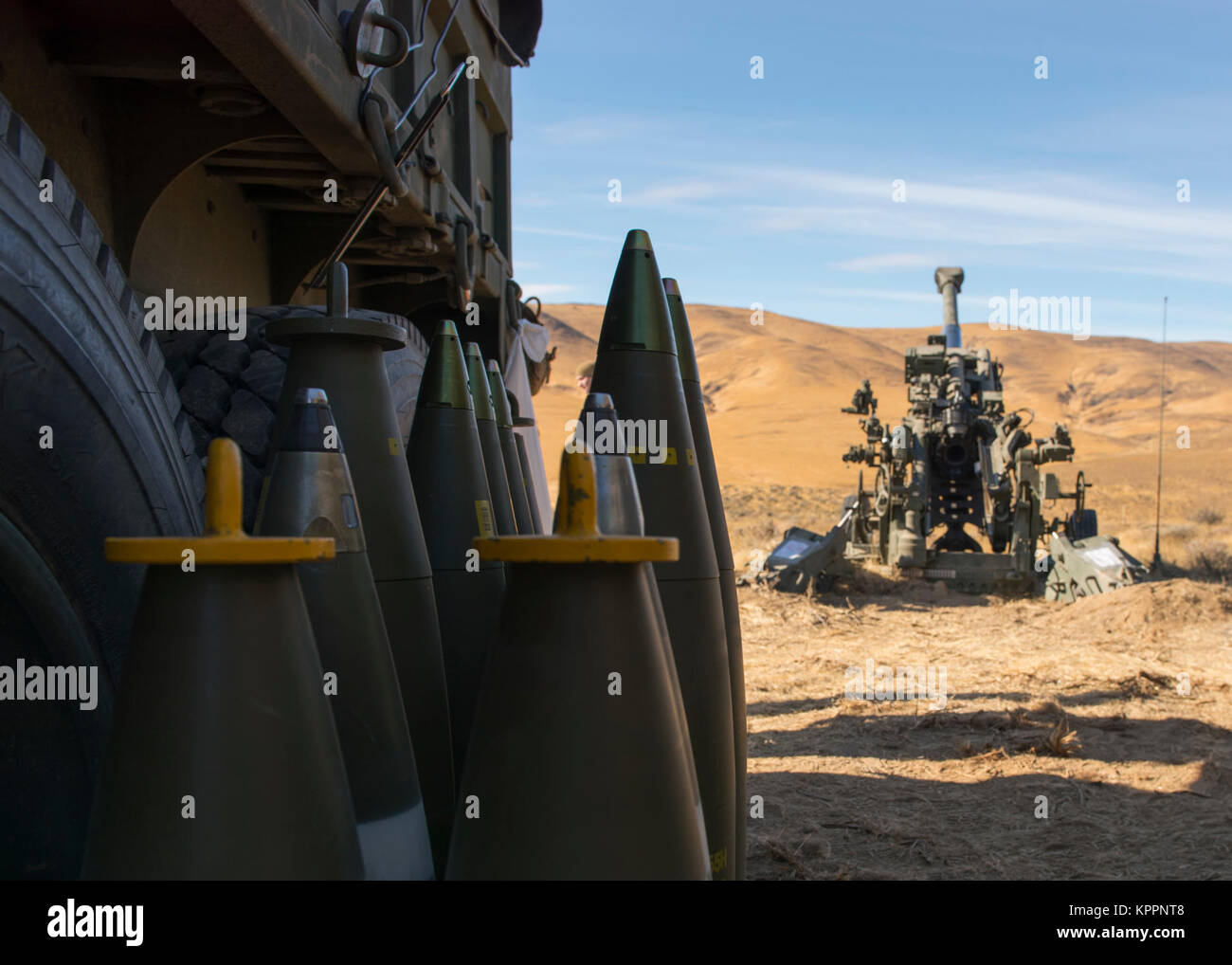 hight resolution of 155 mm projectiles for a m777a2 howitzer sit beside their ammo truck during a live
