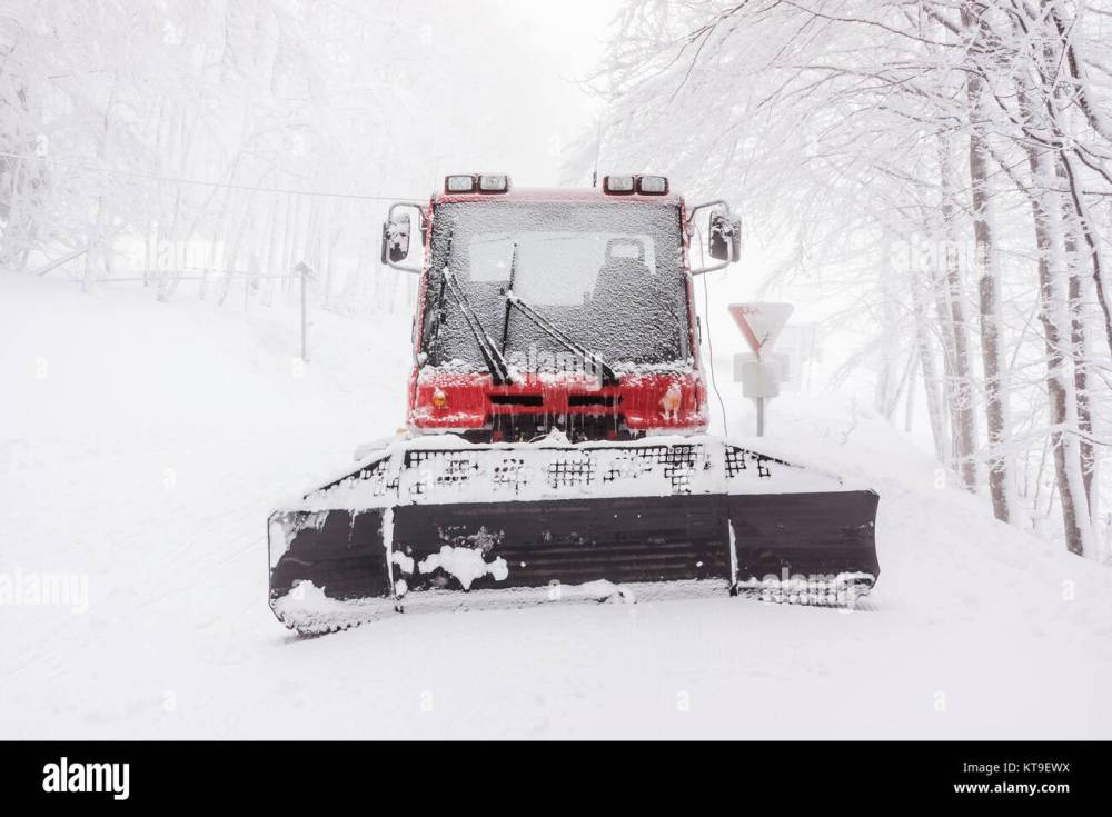 medium resolution of front view of a snowy snow plow in winter on a foggy day vosges