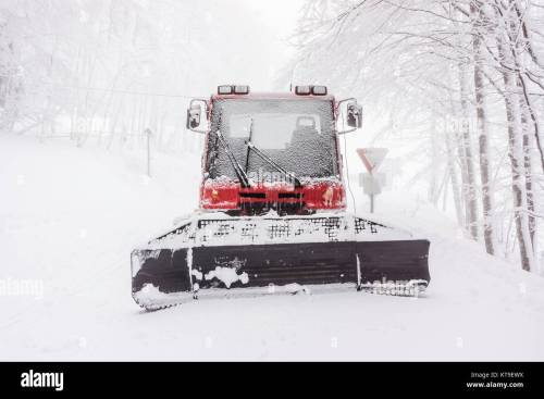 small resolution of front view of a snowy snow plow in winter on a foggy day vosges