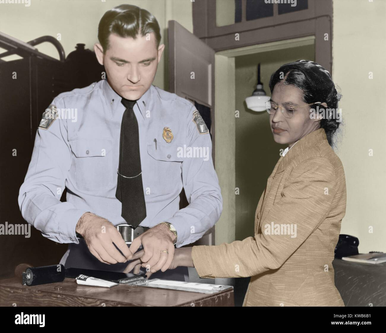 hight resolution of rosa parks is finger printed by deputy sheriff d h lackey in montgomery alabama