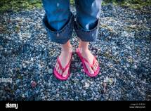 Girl Barefoot On Gravel