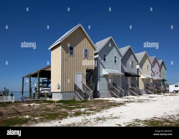 Fishing houses line the beach on Dauphin Island, Alabama