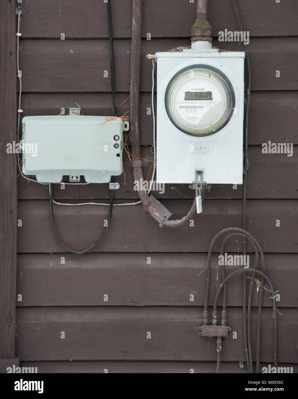 hight resolution of an electric meter telephone box and cable television utility connections on the outside of a