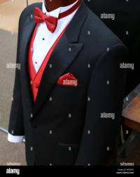 Black Tuxedo With Red Vest And Tie