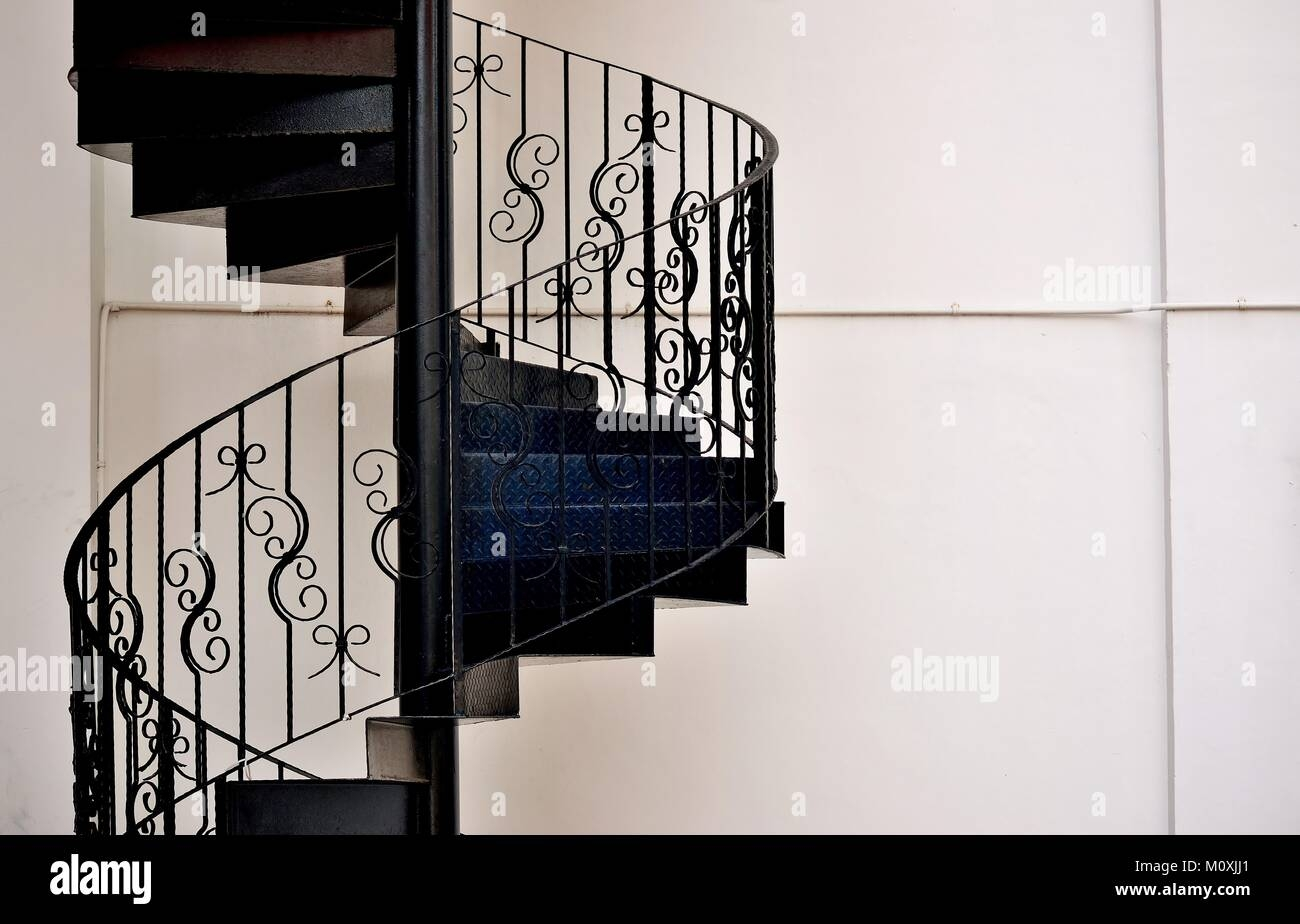 Elegant Metal Exterior Spiral Staircase On The Side Of A House In | Exterior Metal Spiral Staircase | Rustic Metal | Deck | Crystal Handrail | Bar Modern | Railing