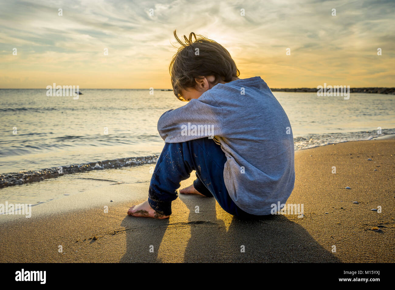 sad boy beach stock