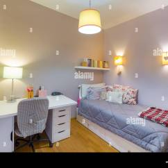 Bedroom Chair On Wheels Striped Accent Chairs Cozy Interior Of A Young Woman With White Laminate Desk Single Bed Books The Walls And Lamps All An Oak Flo