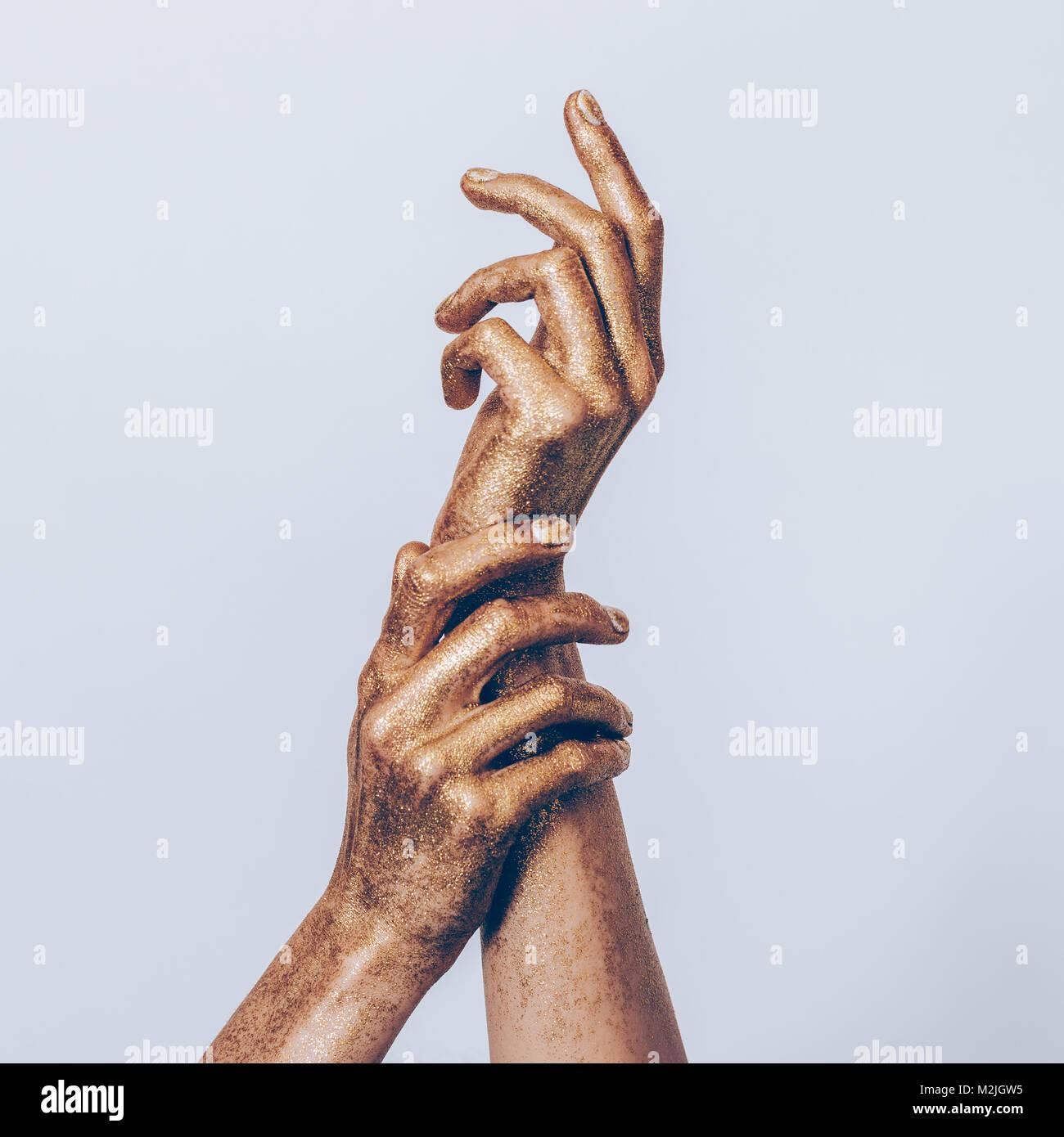 golden female hands posing