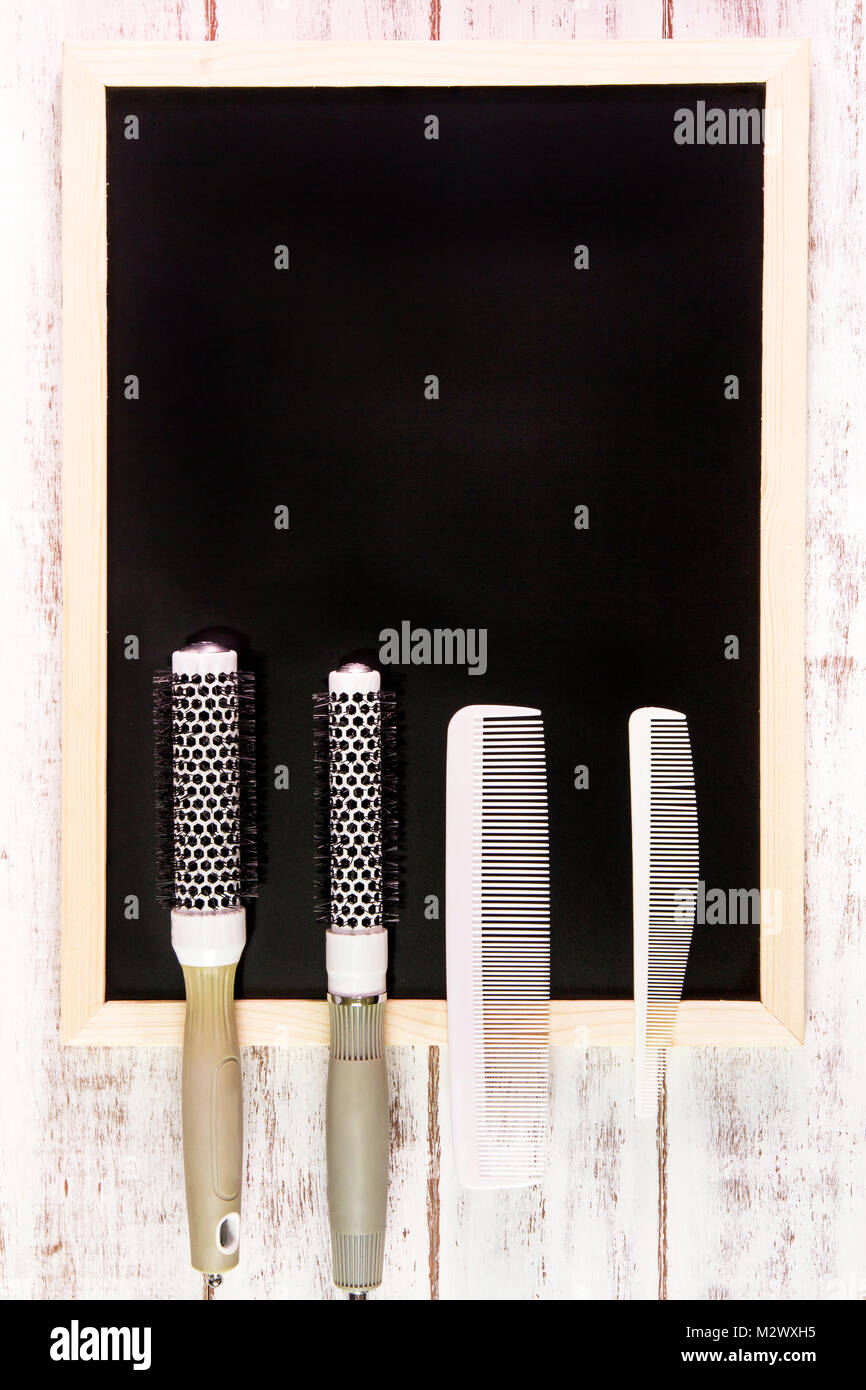 Blank Blackboard And Hairdresser's Comb On Wooden Table.template Mock Up  For Adding Your Design And Leave Space Beside Frame For Adding More Text.