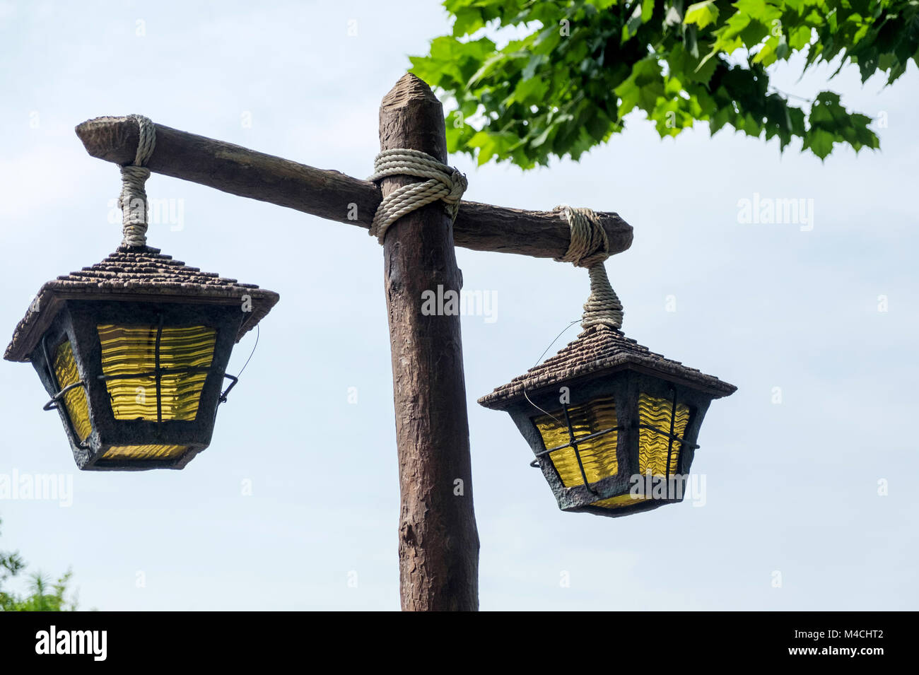 https www alamy com stock photo close up of rustic wooden lamp post tied with rope two old lamps with 174839730 html