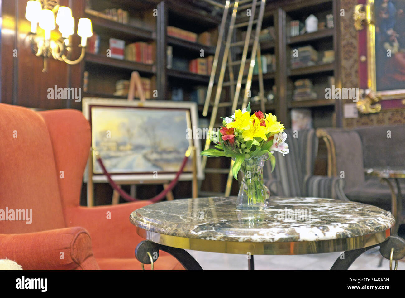 https www alamy com stock photo an orange chaucer wing chair next to a cocktail table with fresh flowers 175082201 html