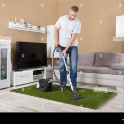 Sofa Cleaner Home Goods Throws Stock Photos Images Alamy Young Man Cleaning Carpet With Vacuum In Living Room Image