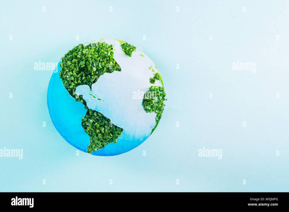 medium resolution of earth model made of paper and fresh green sprouts collage on blue background green planet creative concept earth day selective focus space for tex