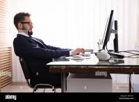 Man Sitting In Bad Posture Working On Computer In Office ...