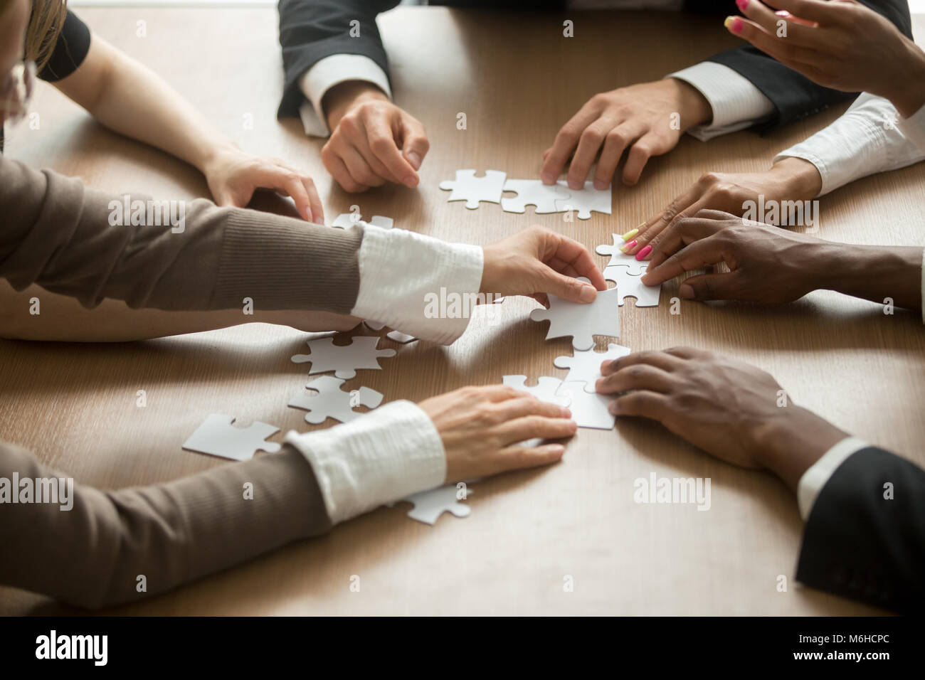 diverse business people helping