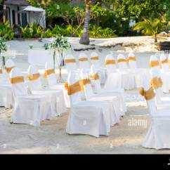 White Armchair Cover Chair Cushion Covers Ebay A Group Of Spandex Chairs With Gold Organza Sash For Beach Wedding Venue