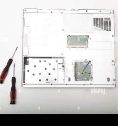 back side of a modern laptop computer without battery lying on a white background viewed from above in a maintenance and diy repair concept [ 1300 x 956 Pixel ]