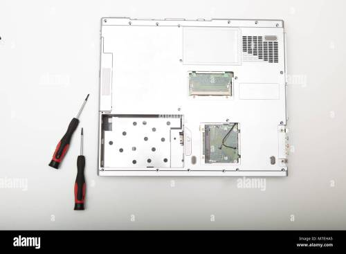 small resolution of back side of a modern laptop computer without battery lying on a white background viewed from above in a maintenance and diy repair concept