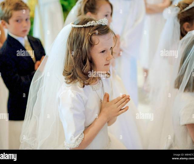 Catholic Boys And Girls Receiving The Sacrament Of First Holy Communion Stock Image