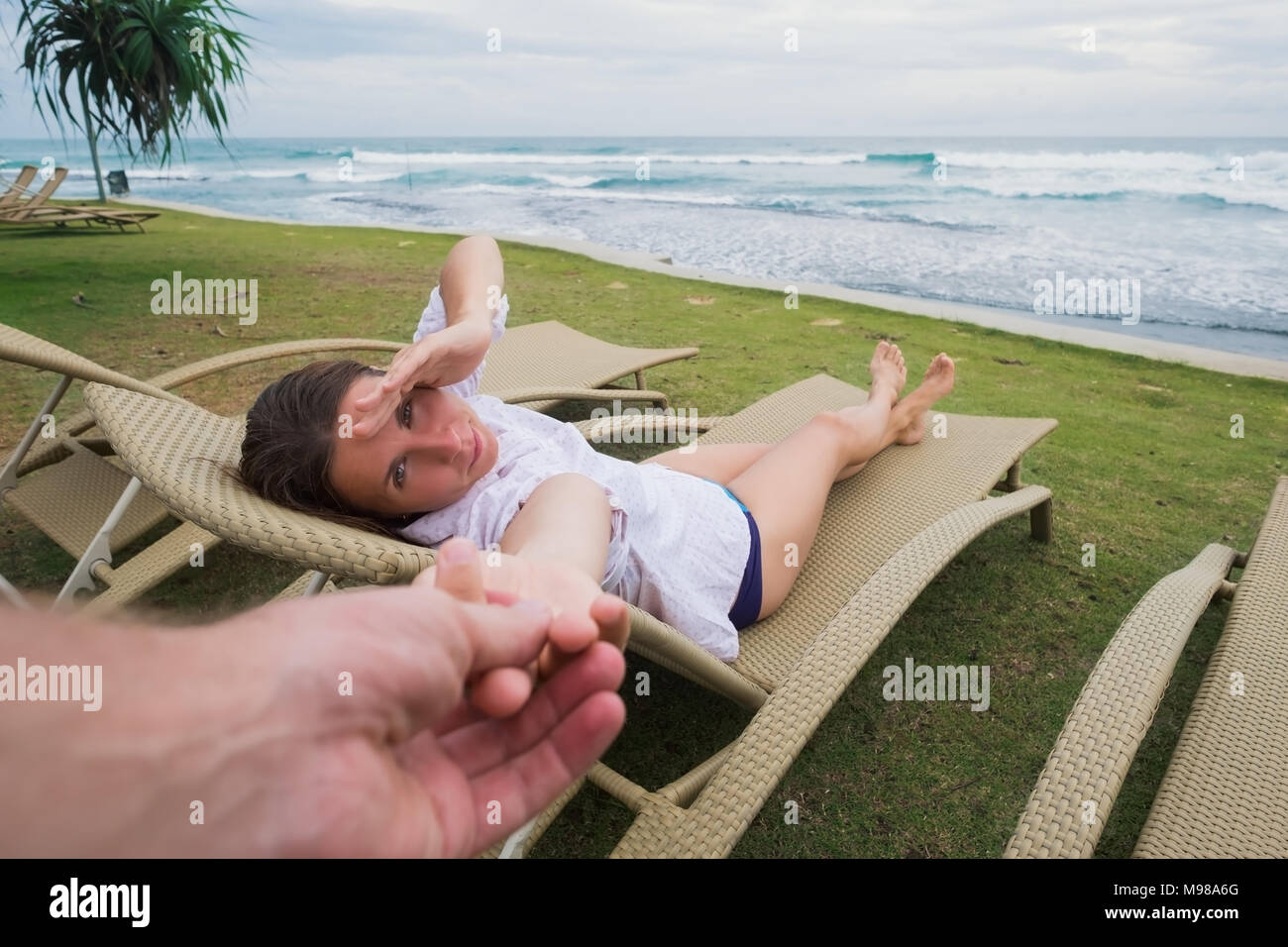Caucasian Woman In Chair Near Beach Holding Her Husband Hand Follow Me Concept Having Great Vacation Near Seashore In Hotel Stock Photo Alamy