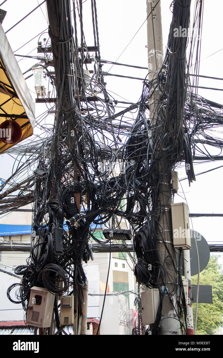 hight resolution of many electrical cable and telephone line on electricity post saigon vietnam messy wires attached to the electric mast