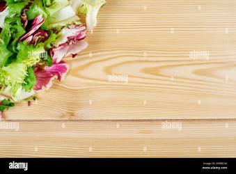 fresh green salad on wooden background Healthy natural food mockup for recipe or menu Stock Photo Alamy